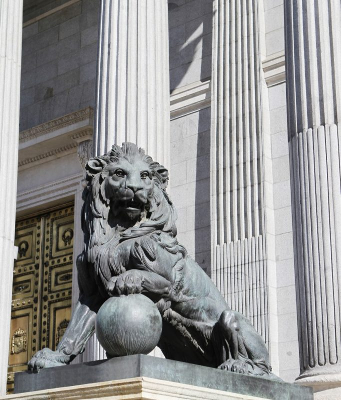 Lion statue in front of the Congress of Deputies building in Madrid, Spain